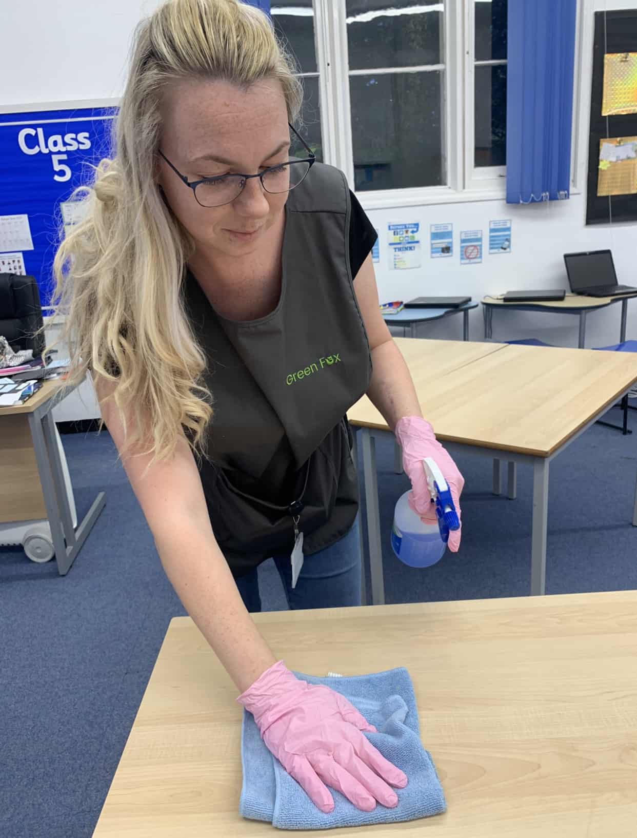 Green Fox employee completing school cleaning services
